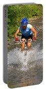 A Woman Mountain Bikes Along Trail 401 Portable Battery Charger