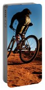 A Middle Age Man Rides His Mountain Portable Battery Charger