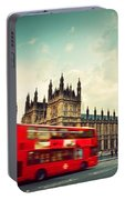 London Uk Red Bus In Motion And Big Ben Portable Battery Charger