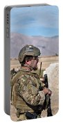 A Coalition Force Member Maintains Portable Battery Charger