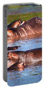Hippopotamus In River. Serengeti. Tanzania Portable Battery Charger