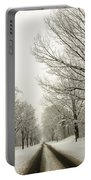 Snow Covered Road And Trees After Winter Storm Portable Battery Charger