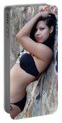 Young Hispanic Woman Portable Battery Charger