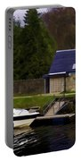 Small White Yacht In The Water Of The Caledonian Canal Portable Battery Charger
