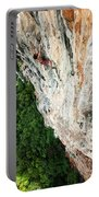 A Athletic Man Rock Climbing High Portable Battery Charger
