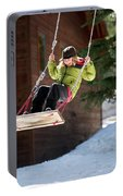 A Boy Plays Outside In Lake Tahoe Portable Battery Charger