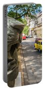 A Bronze Lion Guards Historic Buildings Portable Battery Charger