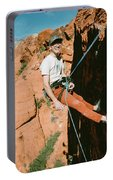 A Climber On Panty Wall In Red Rock Portable Battery Charger