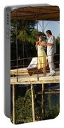 A Couple Having Drinks On A Deck Portable Battery Charger