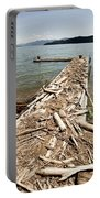 A Dock Covered With Driftwood Portable Battery Charger
