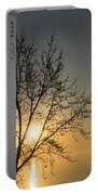 A Filigree Of Branches Framing The Sunrise Portable Battery Charger