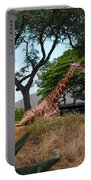 A Giraffe Rests In Honolulu Portable Battery Charger
