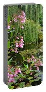 A Glimpse Of Monet's Pond At Giverny Portable Battery Charger