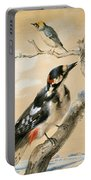 A Great Spotted Woodpecked And Another Small Bird Portable Battery Charger