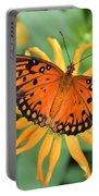 A Gulf Fritillary Butterfly On A Yellow Daisy Portable Battery Charger