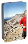 A Hiker Uses His Smartphone To Capture Portable Battery Charger