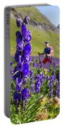 A Male Hiker In Sunny Flower Field Portable Battery Charger