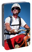 A Male Mountain Biker Stops To Enjoy Portable Battery Charger