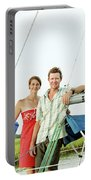 A Man And A Woman Embrace In Sailboat Portable Battery Charger