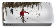 A Man And Woman Cross Country Skiing Portable Battery Charger