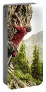 A Man Clinging To Rock Face In The Portable Battery Charger