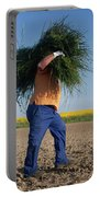 A Man Harvests Sedge To Be Used Portable Battery Charger