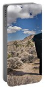 A Man Looks Into The Distance Portable Battery Charger