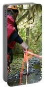 A Man Lowers A Rope For Canyoning Portable Battery Charger