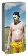 A Mans Face Covered In Clay Mud Portable Battery Charger