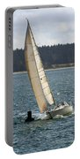 A Sailing Yacht Rounds A Buoy In A Close Sailing Race Portable Battery Charger