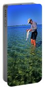 A Salt Water Fly Fisherman Catches Portable Battery Charger