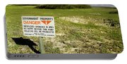 A Sign Warns Of Dangerous Unexploded Portable Battery Charger