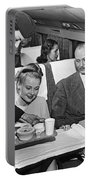 A Stewardess Serving Breakfast Portable Battery Charger by Underwood Archives