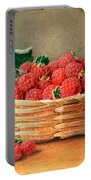 A Still Life Of Raspberries In A Wicker Basket  Portable Battery Charger