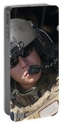 A U.s. Air Force Airman Peers Portable Battery Charger