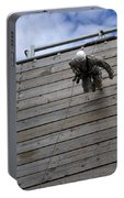 A U.s. Soldier Runs Down A 40-foot Portable Battery Charger