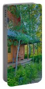 A View Of A Cottage With Aspen Trees Portable Battery Charger