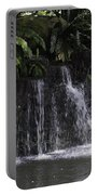 A Waterfall As Part Of An Exhibit Inside The Jurong Bird Park Portable Battery Charger
