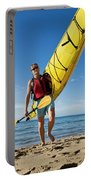 A Woman Carrying Her Sea Kayak Portable Battery Charger
