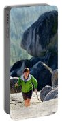 A Woman Hiking High In The Mountains Portable Battery Charger