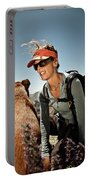 A Woman  Talks To Her Dog While Taking Portable Battery Charger