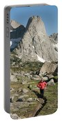A Woman Trail Running In The Cirque Portable Battery Charger