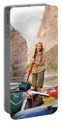A Woman Unloads Gear From Her Canoe Portable Battery Charger