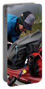 A Woman Unloads Her Kayak Portable Battery Charger