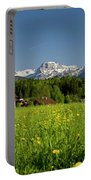 A Woman Walks Through An Alpine Meadow Portable Battery Charger