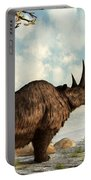 A Woolly Rhinoceros Trudges Portable Battery Charger by Daniel Eskridge