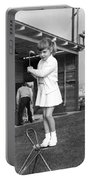 A Young Girl Hits A Golf Ball Portable Battery Charger