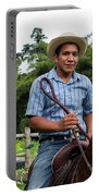 A Young Man Sits On A Horse And Smiles Portable Battery Charger