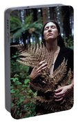 A Young Woman Cradles A Fern Frond Portable Battery Charger