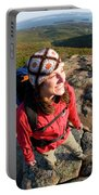 A Young Woman Hiking On Cadillac Portable Battery Charger
